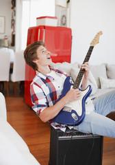 Man strumming guitar and singing