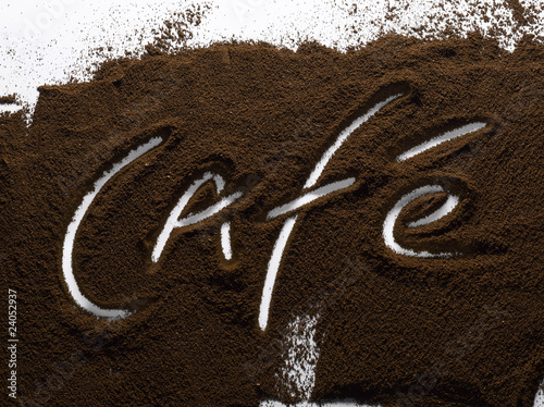 "the word ""café"" written in ground coffee"
