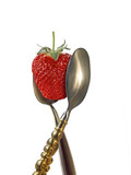 two spoons with strawberry