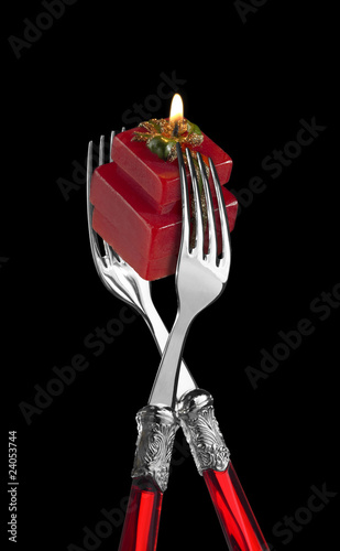 two forks with present-shaped candle