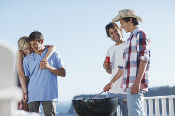Friends barbecuing