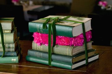 pile of books and carnations