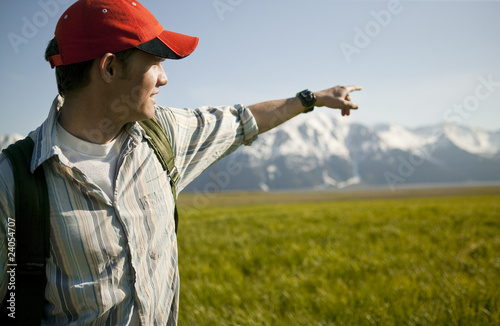 Man pointing in remote valley