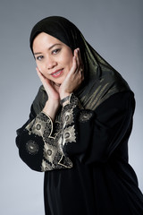 Young Muslim Malay woman in black hijab