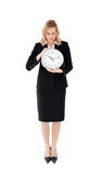 Glum businesswoman holding a clock