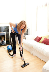 Disintersest woman cleaning her living room