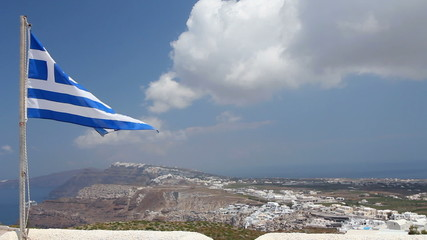Greek Flag On Santorini With Town Of Fira In Background