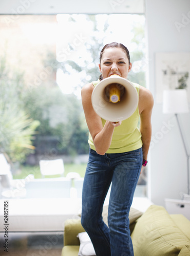 Woman shouting into bullhorn in living room