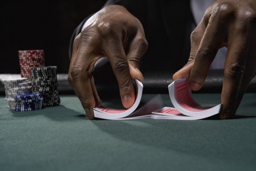 Dealer shuffling cards in casino