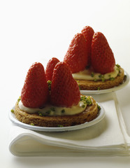 strawberry and pistachio shortbread tartlets