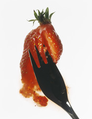squashing a strawberry with a fork