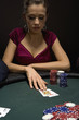 Woman playing blackjack in casino