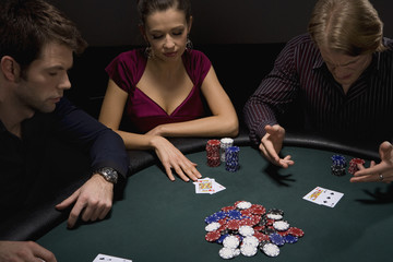 Frustrated man playing cards in casino