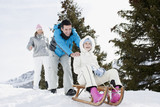 Family sledding in show