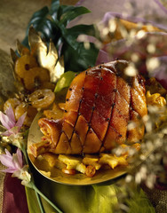 leg of lamb pricked with cloves,pineapple and kumquats