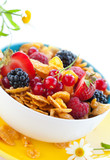 bowl of cornflakes with milk and fruits