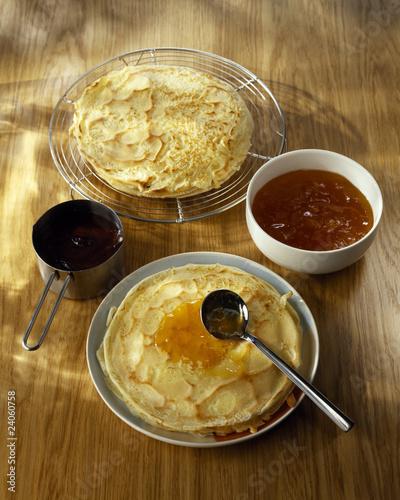 spreading the orange marmelade on the pancakes