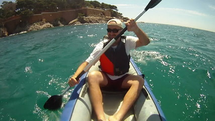 Man paddling in Kayak on the sea