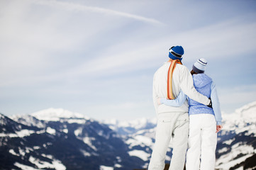 Couple standing on snowy mountain top