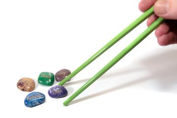 five affirmation stones and chopsticks