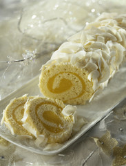 mango cream and coconut rolled log cake