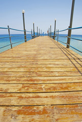 Wooden jetty on a tropical beach