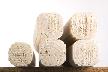 Stack of wooden 4X4s on white background