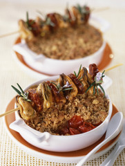 tomato crumble with mussel and chorizo brochettes