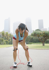 Woman resting after exercising with skipping rope