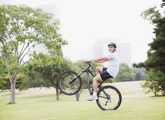 Man riding bicycle in urban park