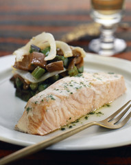 baked piece of salmon with vegetables