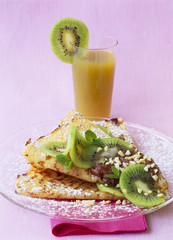 pancake with melted chocolate and kiwi