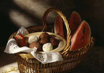 basket with watermelon and chocolate and coconut balls