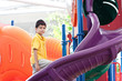 Young boy at colorful outdoor playground