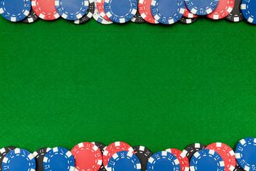 Gambling chips on green felt