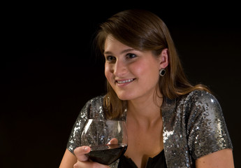 Pretty young woman with red wine, on a date