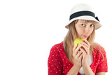 woman in hat holding apple