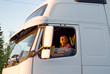 The driver in a cabin of the truck
