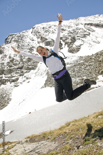 Female hiker leaping for joy