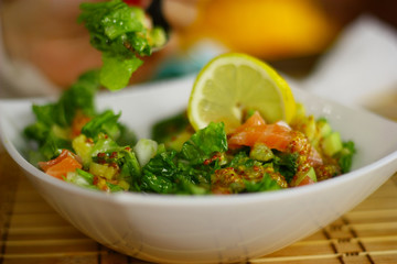 Delicious salade with fish, parsley, cucambers and lemon.