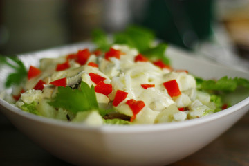 Delicious salade with eggs, parsley and sauce.