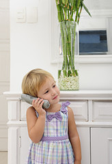 child talking on phone at home