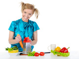 young girl in the kitchen rubbing carrots. poster