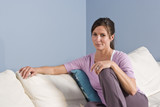 Portrait of woman sitting on couch at home
