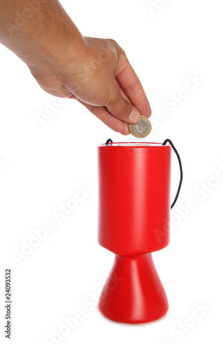 Man donating two pounds to charity