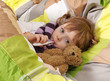 Little girl lying sick in bed