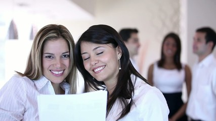 Business women holding documents