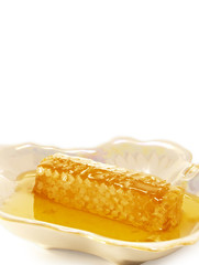 Honey in the comb. On a white background.