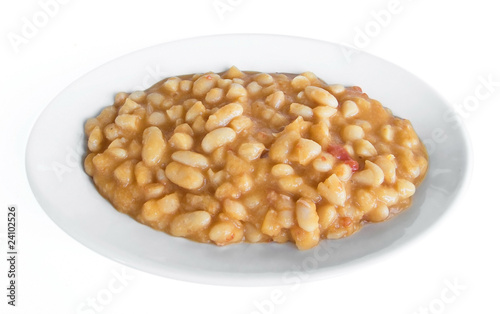 Beans soup on white dish.