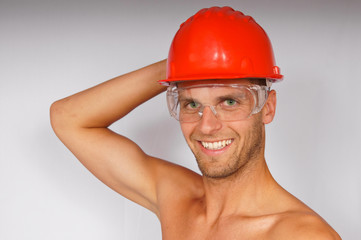 Young attractive man in a protective helmet and goggles